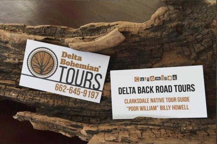 The DB Tours Business Cards on wood